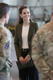 Kate Middleton accessorized with a military-green suede clutch by L.K.Bennett during an official visit to RAF Akrotiri.