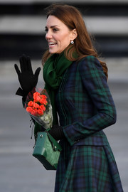 Kate Middleton paired a green leather and suede purse by Manu Atelier with a tartan coat for her visit to Dundee.