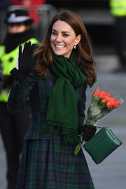 Kate Middleton accessorized with a green pashmina for extra warmth to her tartan coat while visiting Dundee.