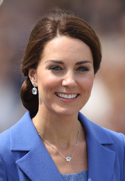 Kate Middleton wore a blue topaz pendant and matching earrings by Kiki McDonough on day 1 of her official visit to Germany.