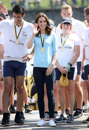 Kate Middleton donned a long-sleeve striped tee by Hugo Boss to participate in a rowing race in Heidelberg, Germany.