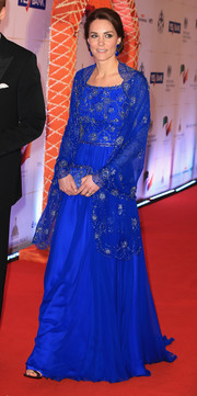 Kate Middleton stunned in an embellished royal-blue gown and wrap by Jenny Packham while attending a charity gala in India.
