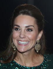 Kate Middleton attended a special reception during the royal tour of Pakistan wearing this sweet half updo.