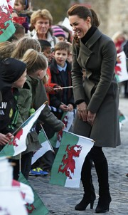 Kate Middleton looked stylishly dressed for cold weather in a gray wool coat by Reiss while visiting north Wales.