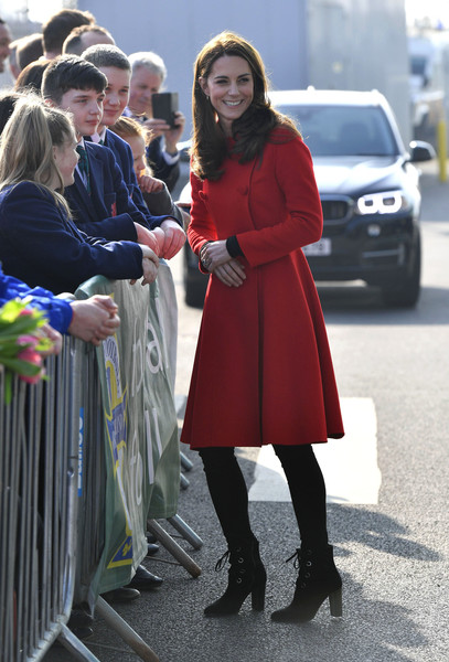Kate Middleton visited the National Stadium in Belfast wearing a stylish red coat by Carolina Herrera.