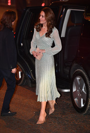 Kate Middleton looked classy, as always, in a pale blue lurex wrap dress by Missoni while visiting the Empire Music Hall in Belfast.