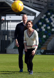 Kate Middleton donned a white V-neck sweater by Ralph Lauren for her visit to the National Stadium in Belfast.
