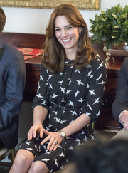 Kate Middleton kept it modest in a black-and-white swallow-print dress by Jonathan Saunders while receiving visitors at Kensington Palace.