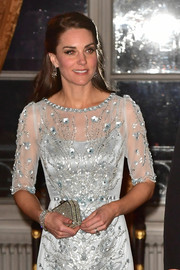 Kate Middleton teamed a diamond bracelet with a crystal clutch and a sequined gown for a totally radiant look during the British Embassy dinner in Paris.