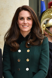 Kate Middleton sported gorgeous face-framing waves on day one of her Paris trip.