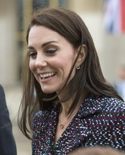 Kate Middleton teamed her earrings with a matching pendant necklace.