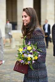 Kate Middleton accessorized with a quilted burgundy calfskin purse by Chanel on day 2 of her Paris trip.