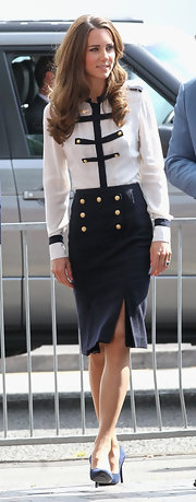 Kate Middleton showed her support of the riot victims with a visit to Summerfield Community Centre. The Duchess of Cambridge opted to wear an Alexander McQueen Pre-Fall 2011 ensemble.