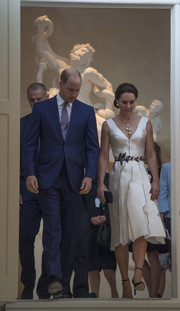 Kate Middleton looked absolutely dreamy in a structured white Gosia Baczynska cocktail dress with black trim during the Queen's birthday garden party in Poland.
