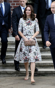 Kate Middleton looked demure and girly in a floral top by Erdem while touring the Stutthof concentration camp in Poland.