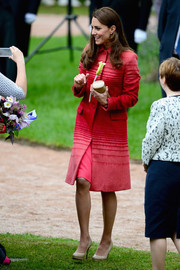 Kate Middleton looked lively in an ombre wool coat by Jonathan Saunders during a tour of Scotland.