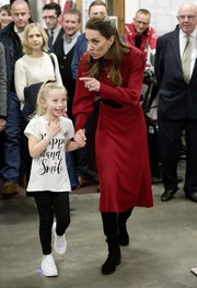 Kate Middleton visited the Bulldogs Boxing Club in Wales wearing a red sweater dress by Zara.