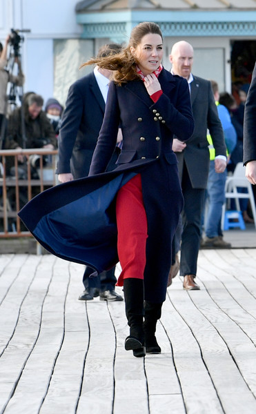 Kate Middleton bundled up in a navy wool coat by Hobbs for a windy day in South Wales.