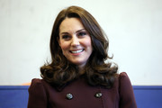 Kate Middleton framed her face with bouncy curls for her visit to Hartvig Nissen School in Norway.