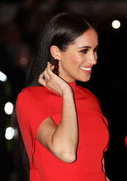 Meghan Markle kept it simple yet elegant with this long straight 'do at the Mountbatten Music Festival.