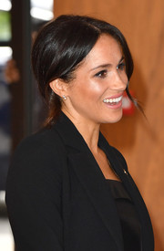 Meghan Markle styled her hair into a simple chignon for the WellChild Awards.