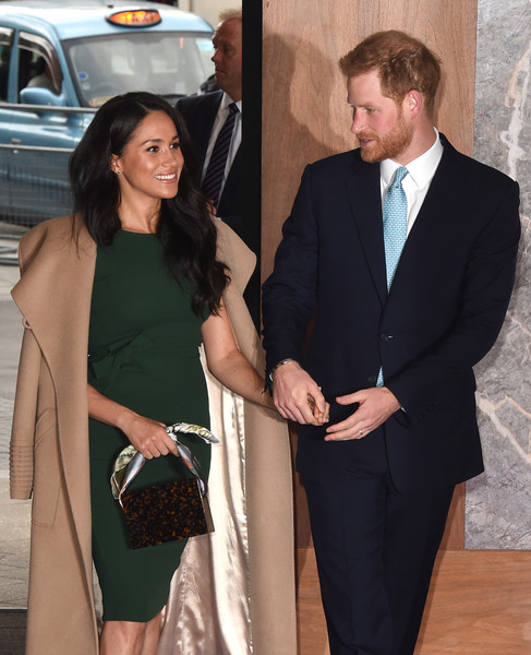 Meghan Markle attended the WellChild Awards carrying a scarf-handle bag by Montunas.