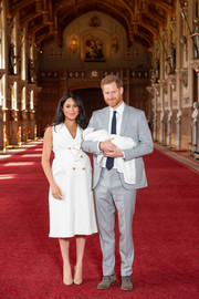 Meghan Markle debuted baby Sussex wearing a sleeveless white trench dress by Grace Wales Bonner.