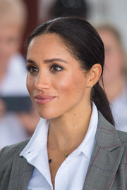 Meghan Markle wore her hair in a center-parted ponytail while attending a ceremony in Dubbo, Australia.