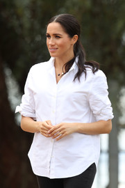 Meghan Markle was classic in a white button-down by Maison Kitsune while visiting a farm in Dubbo, Australia.