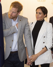 Meghan Markle was all business in a white pinstriped blazer by L'Agence while attending a reception hosted by the Prime Minister of Australia.