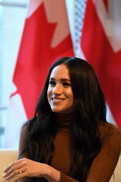 Meghan Markle wore her hair down with a center part when she visited Canada House in London.