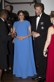 Meghan Markle looked downright regal in a caped blue column dress by Safiyaa while attending a State dinner in Fiji.