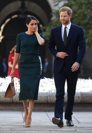 Meghan Markle started her official two-day visit to Dublin wearing a green knit top by Givenchy.