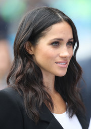 Meghan Markle wore her hair loose in a center-parted wavy style during her visit to Croke Park in Ireland.