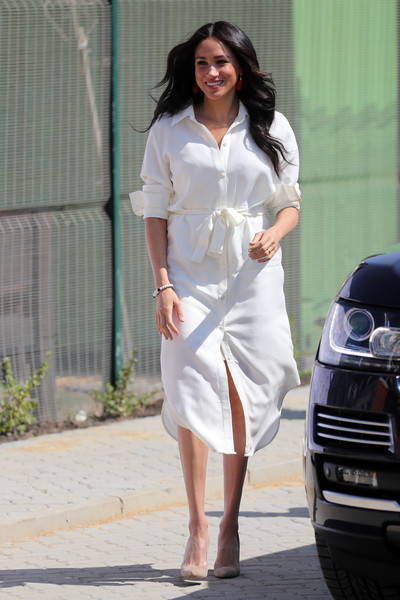 Meghan Markle looked effortlessly stylish in a white shirtdress by Hannah Lavery while touring Johannesburg, South Africa.