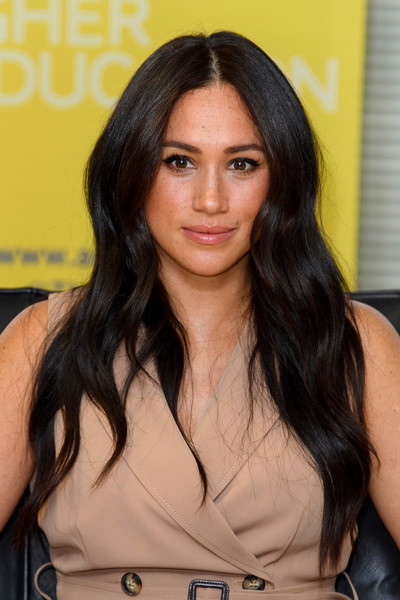Meghan Markle looked beautiful with her face-framing waves while visiting the University of Johannesburg.