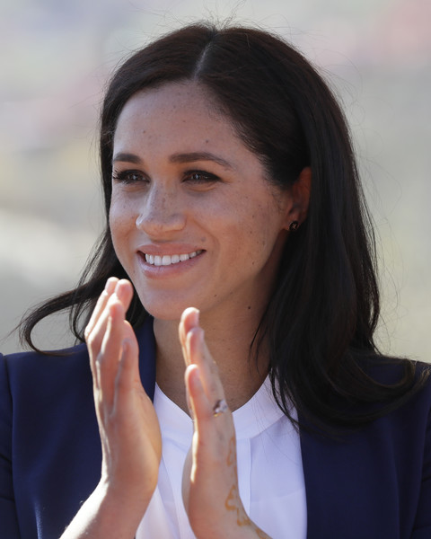 Meghan Markle wore a casual side-parted hairstyle at the Investiture for Michael McHugo in Morocco.