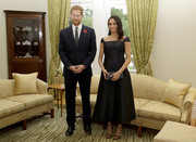 Meghan Markle looked regal in a tea-length black dress by Gabriela Hearst while visiting Government House in New Zealand.