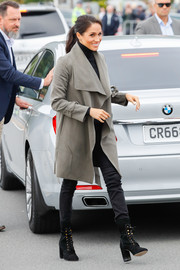 Meghan Markle bundled up in style in a gray Club Monaco trenchcoat with oversized lapels for a day out in Wellington, New Zealand.