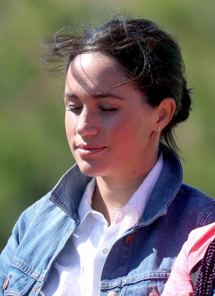 Meghan Markle styled her hair into a casual bun for her visit to Waves for Change in South Africa.