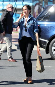 Meghan Markle teamed a Madewell denim jacket with black jeans and a white button-down for her visit to Waves for Change in South Africa.