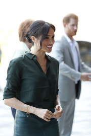 Meghan Markle accessorized with some gold charm bracelets during her visit to Sussex.