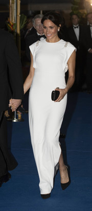 Meghan Markle looked angelic in a white Theia column dress with embellished shoulders while attending a state dinner in Tonga.