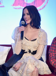 Eva Green looked ultra girly in a white ruffle dress by Alexander McQueen at the 'Dumbo' global press conference.