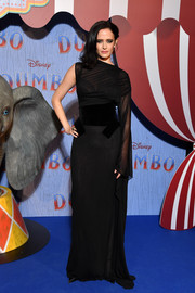 Eva Green went for goth elegance in an asymmetrical black gown by Tom Ford at the Paris screening of 'Dumbo.'