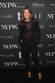 Nina Garcia showed some skin in a sheer black top at the E!, ELLE, and IMG NYFW kickoff celebration.