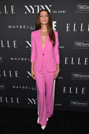 Angela Sarafyan couldn't be missed in her hot-pink pantsuit at the E!, ELLE, and IMG NYFW kickoff celebration.