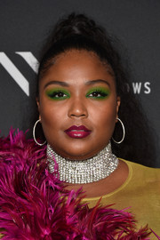 Lizzo gathered her long hair into a high ponytail for the NYFW kickoff event.