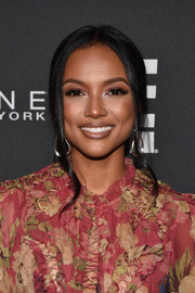 Karrueche Tran opted for a simple center-parted ponytail when she attended the E!, ELLE, and IMG NYFW kickoff celebration.