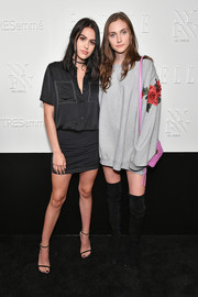 Amelia Gray Hamlin kept it low-key in a short-sleeve black button-down with white trim at the NYFW kickoff party.